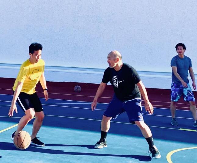 3 men playing basketball