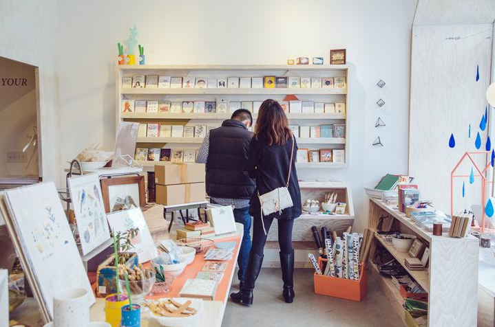A man and a woman are looking at the display shelves