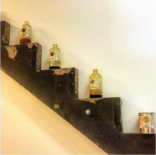 Modern art with liquid containers on the steps of the stairs