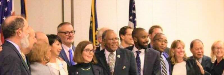 At a diversity conference hosted by the Governor. With the Governor, Mayor (including suburban cities), METRO Bureau Top, Entrepreneurs Association Director, etc. © 2021 PDX COORDINATOR, LLC