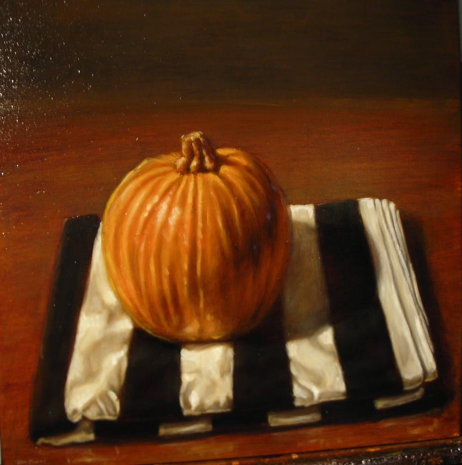 Pumpkin on Striped Cloth
