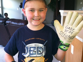 "Gabe & his ""Stay Strong"" Gloves"