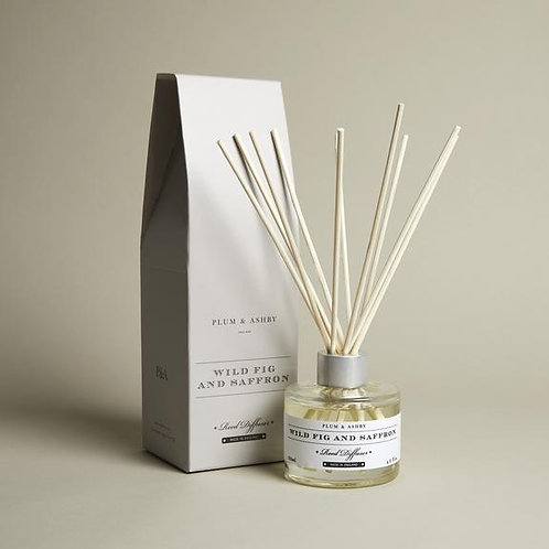 fragranced candle in fig and saffron by plum and ashby