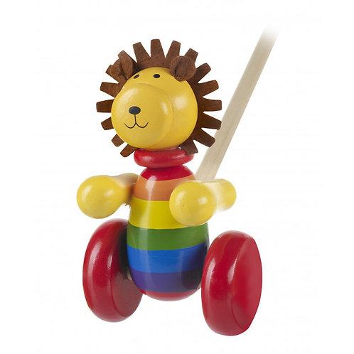 lion push along toy by orange tree