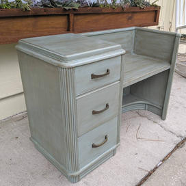 Destressed paint on antique telephone table