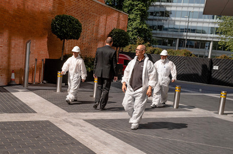 Builders mix with city workers near Towe