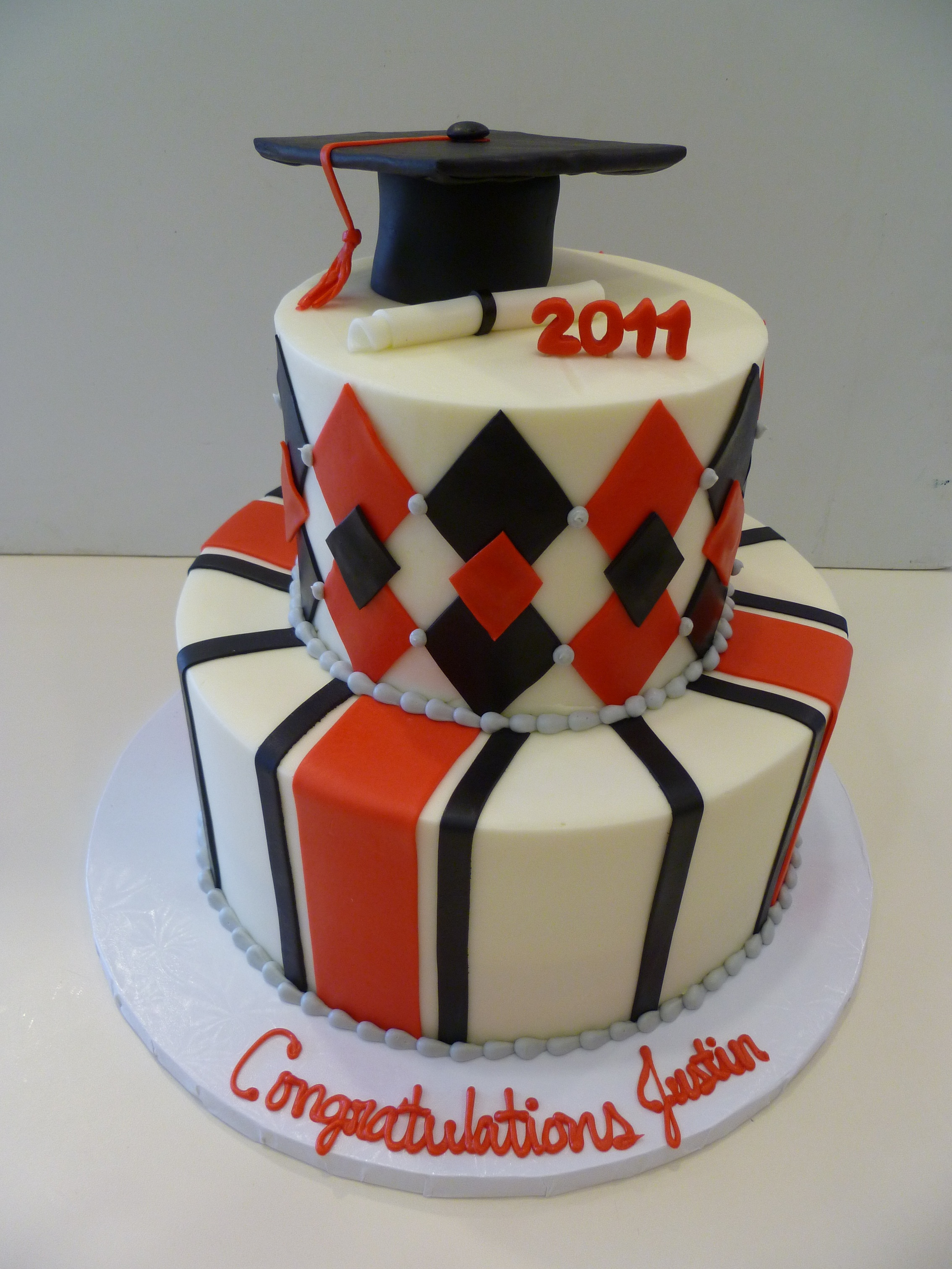 red and black diamond graduation cake