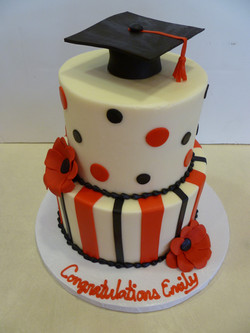 red and black graduation cake