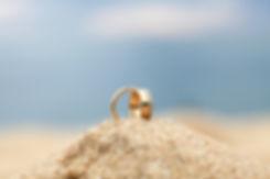gold-wedding-bands-on-sand-3488259.jpg