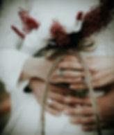 person-holding-white-flowers-1940583.jpg