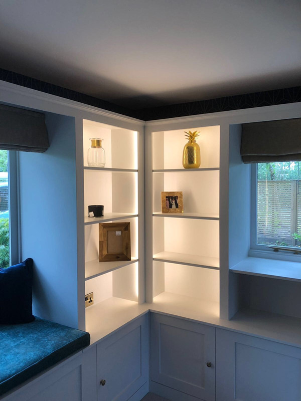 Lounge electrics in a cottage including antiqued brass accessories and shelve lighting in Lymm.
