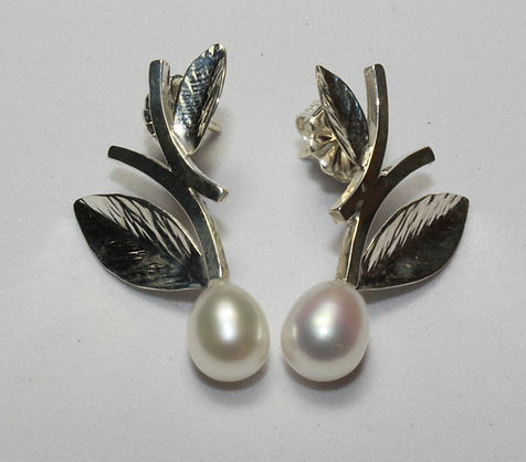 sterling silve earrings in a leaf design with freshwater pearls, handmade by Amanda Hering
