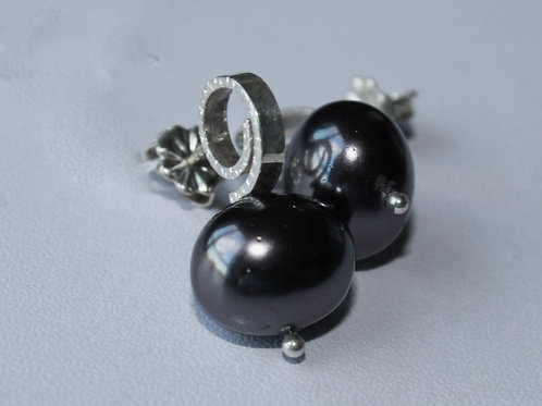 spiral stud earring with egg shaped black pearl