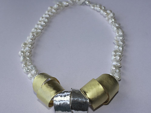 Brass and silver spirals set with pearls and silver