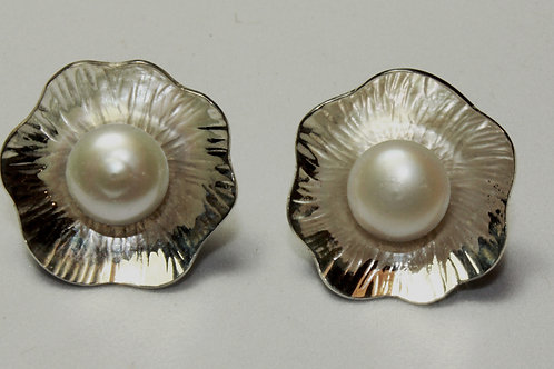 silver post earrings with a floral motif, textured with pearl