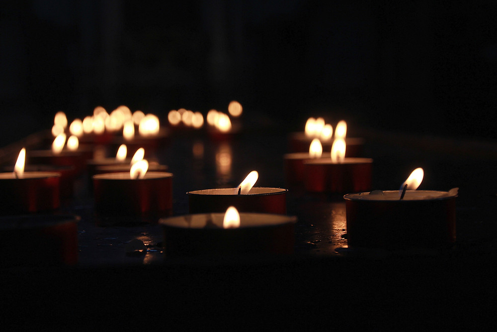 Tea Light Candles. Photo by Zoran Kokanovic on Unsplash
