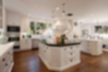 Custom White Cabinets Kitchen by Nickols Cabinetry & Design Inc.