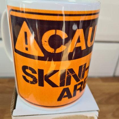 caution skinhead area mug