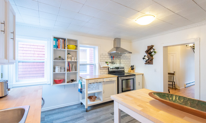 Full kitchen with dishwasher, stove and fridge and all dish & cookware you will need.
