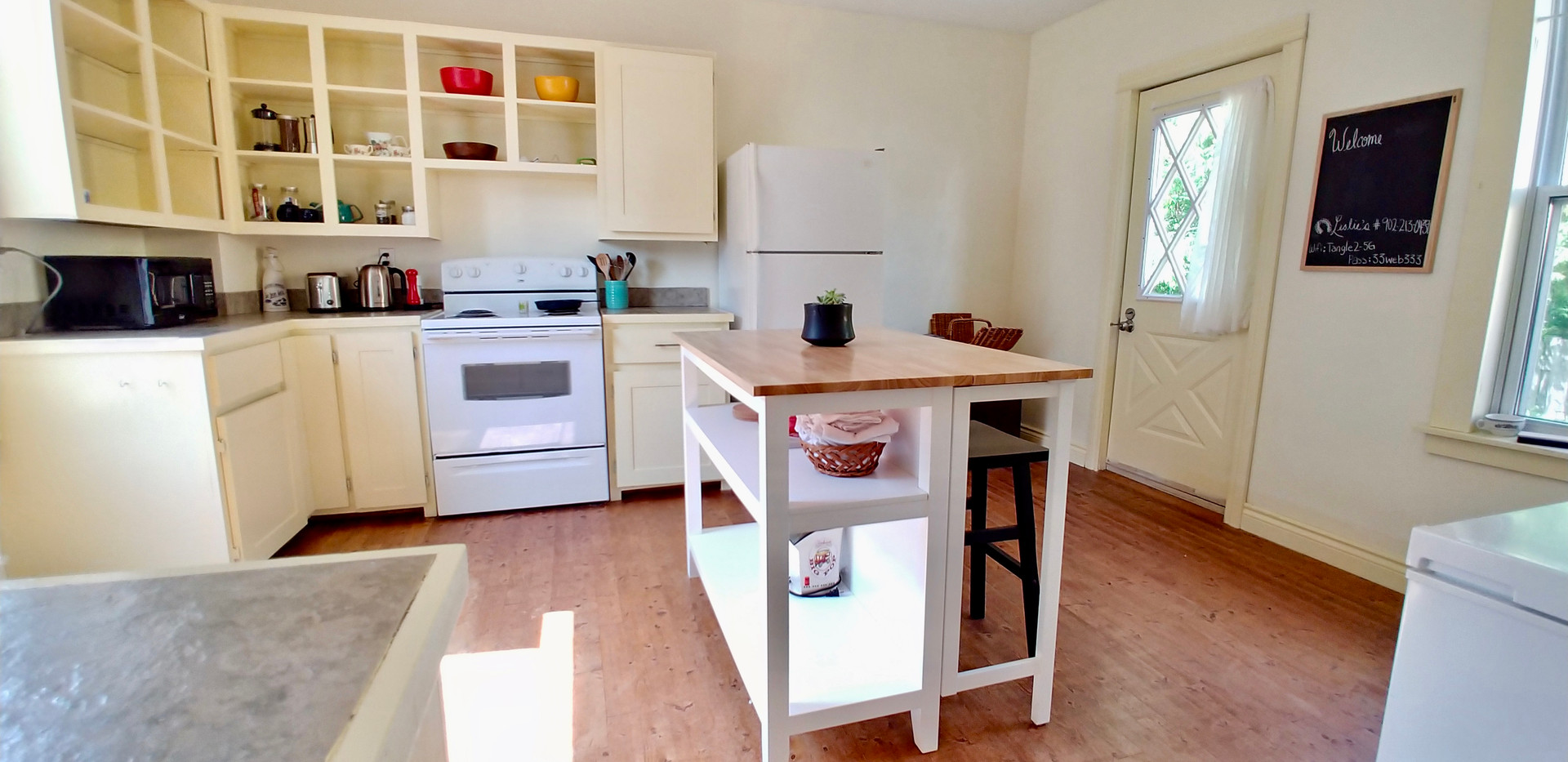 Kitchen with access to back dec