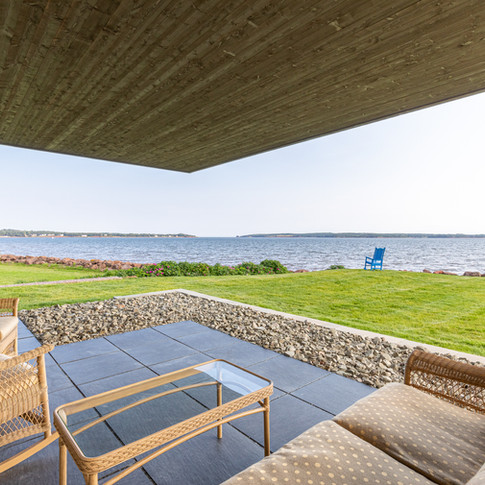 Lounge with your morning coffee on this patio while watching the sailboats, kayaks and birds go by.