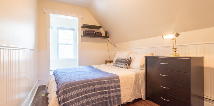 Front bedroom with large walk in closet and queen bed