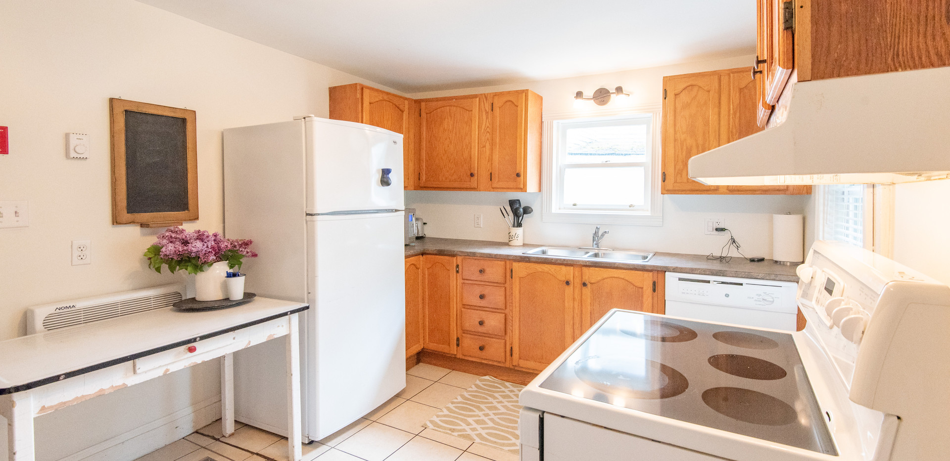 Full Kitchen with stove, fridge, dishwasher and all cookware you will need.