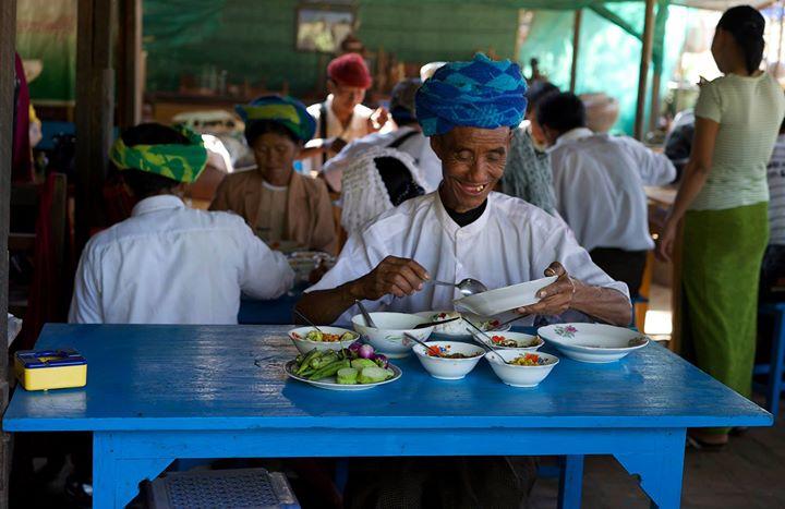 Farmer eating at a main street restaurant in Old Bagan, Bagan Region, Myanmar