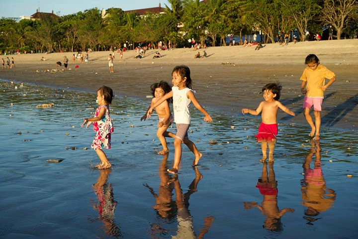 Children playing at Kuta Beach, Bali, Indonesia