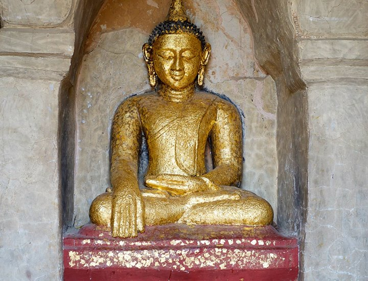 One of thousands golden Buddhas in Old Bagan, Bagan Region, Myanmar