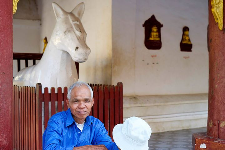 Man resting at the Shwe-zi-gon Pagoda, Nyaung-U, Myanmar