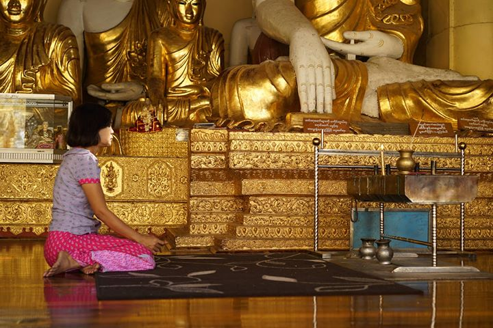 Praying Devotee at One of The Buddhist Temples of Sule Pagoda, Myanmar