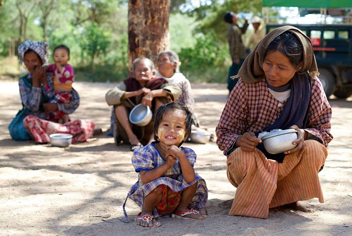 Women and children begging for food outside a Temple in Old Bagan, Bagan Region, Myanmar