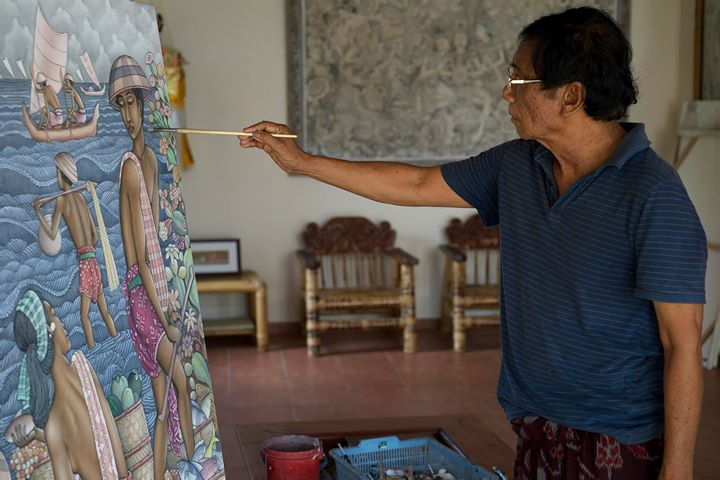 The Balinese painter, Jati I Ketut, at his home studio in Ubud, Bali.__Jati I Ketut is a self-taught