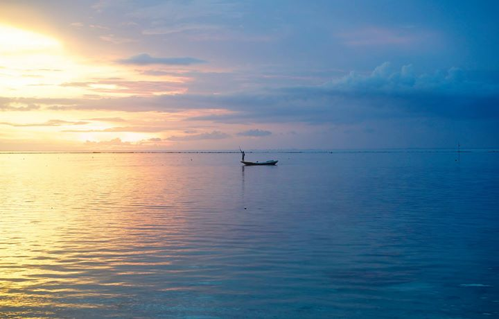 Fisherman at sunset from Mushroom Bay, Nusa Lembongan, Indonesia