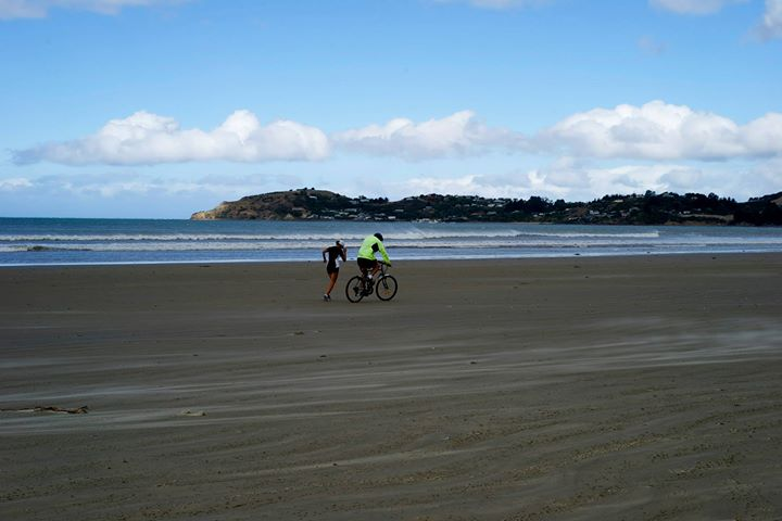 A professional runner at Moeraki Beach, South Island