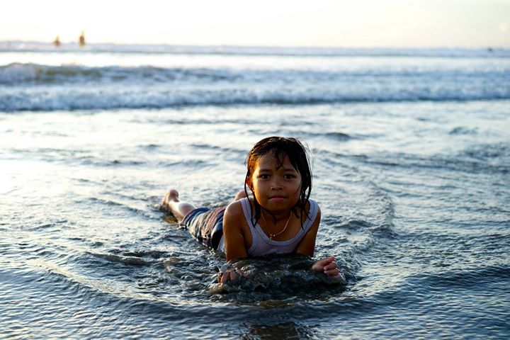 Balinese little girl at Kuta Beach, Bali, Indonesia