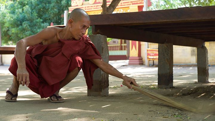 A Buddhist monk sweeping in Old Bagan, Bagan Region, Myanmar