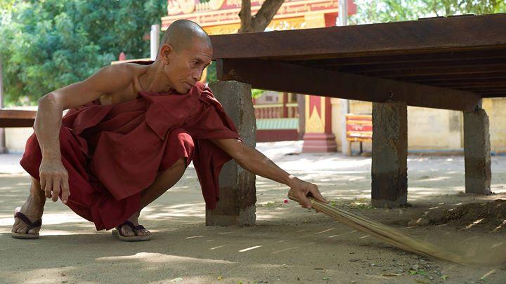 A Buddhist monk sweeping in Old Bagan, Bagan Region, Myanmar