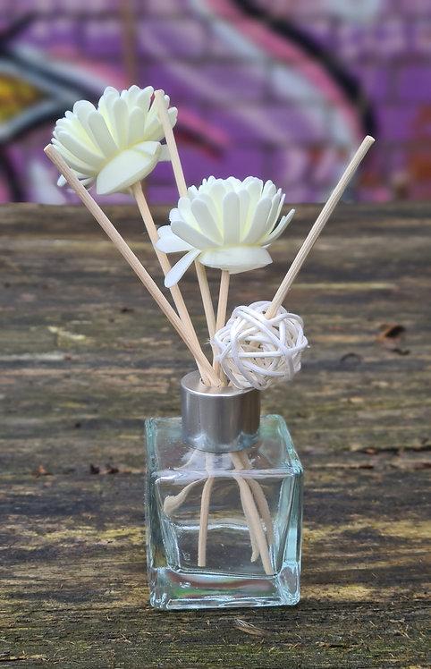 Geurflesje doorzichtig met bloemen en kaartje
