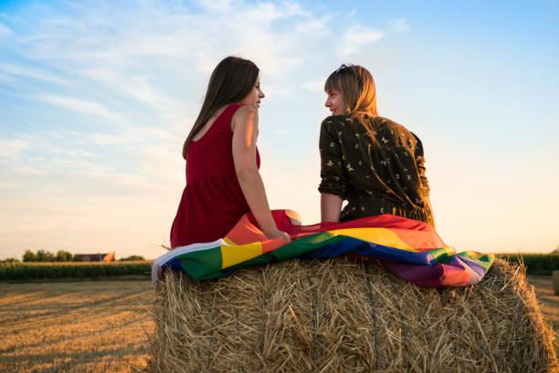 lesbian couple on hay.jpg