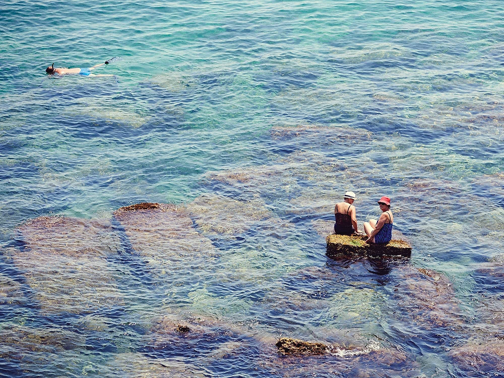 Sicily's crystal-clear waters—seen here off the coast of Ortigia—are home to an array of tasty creatures, from blue-fin tuna and swordfish to sardines and shrimp, all of which feature prominently in the island's cuisine.