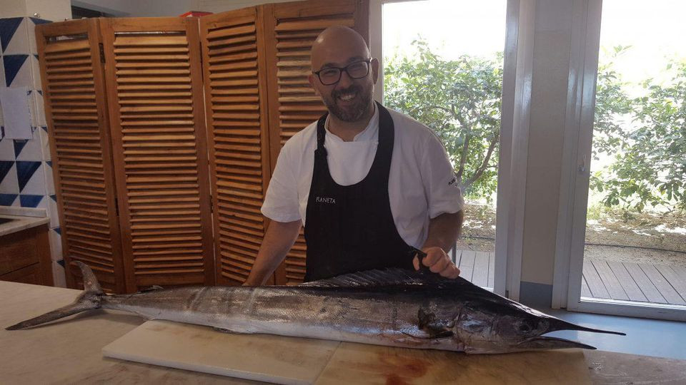 Chef Angelo Pumilia, of Menfi's La Foresteria resort, with the catch of the day. ALEXANDRA KIRKMAN