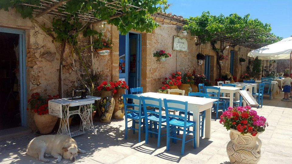 Marzamemi, one of Sicily's most scenic enclaves, captivates visitors with its charming and colorful main square. ALEXANDRA KIRKMAN
