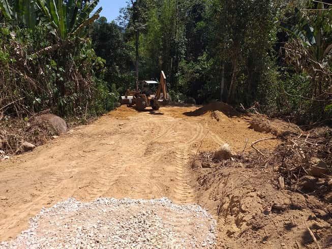 Backhoe access road construction