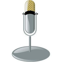 Picture of an old microphone on a table stand, commonly referred to as a corncob mike.