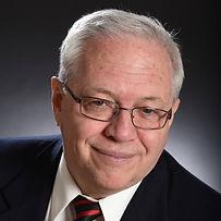 Head shot photo of author, Ron Finnigan, smiling.