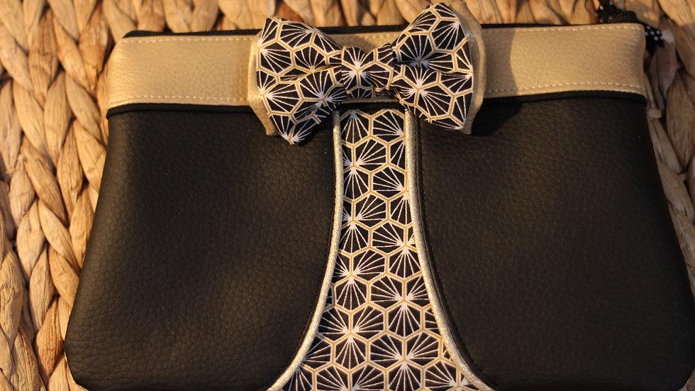 Trousse ninie noire et or avec noeud