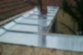 Entreprise de zinguerie GUERDENER artisan zingueur Refection d'une toiture en tole imitation tuile Refection d'une toiture en tole imitation tuile à Brignais, Lyon et tout le Rhone 69
