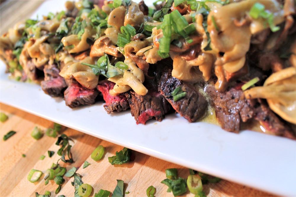 Flank steak with chanterelle mushrooms